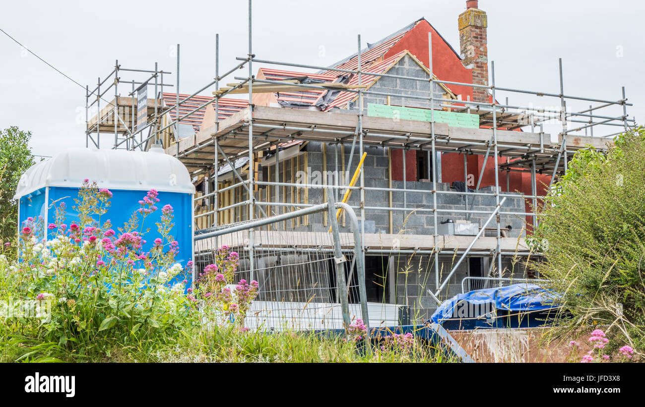 Scaffolding around a new house being built in Mortehoe, Devon, England, UK. - Stock Image