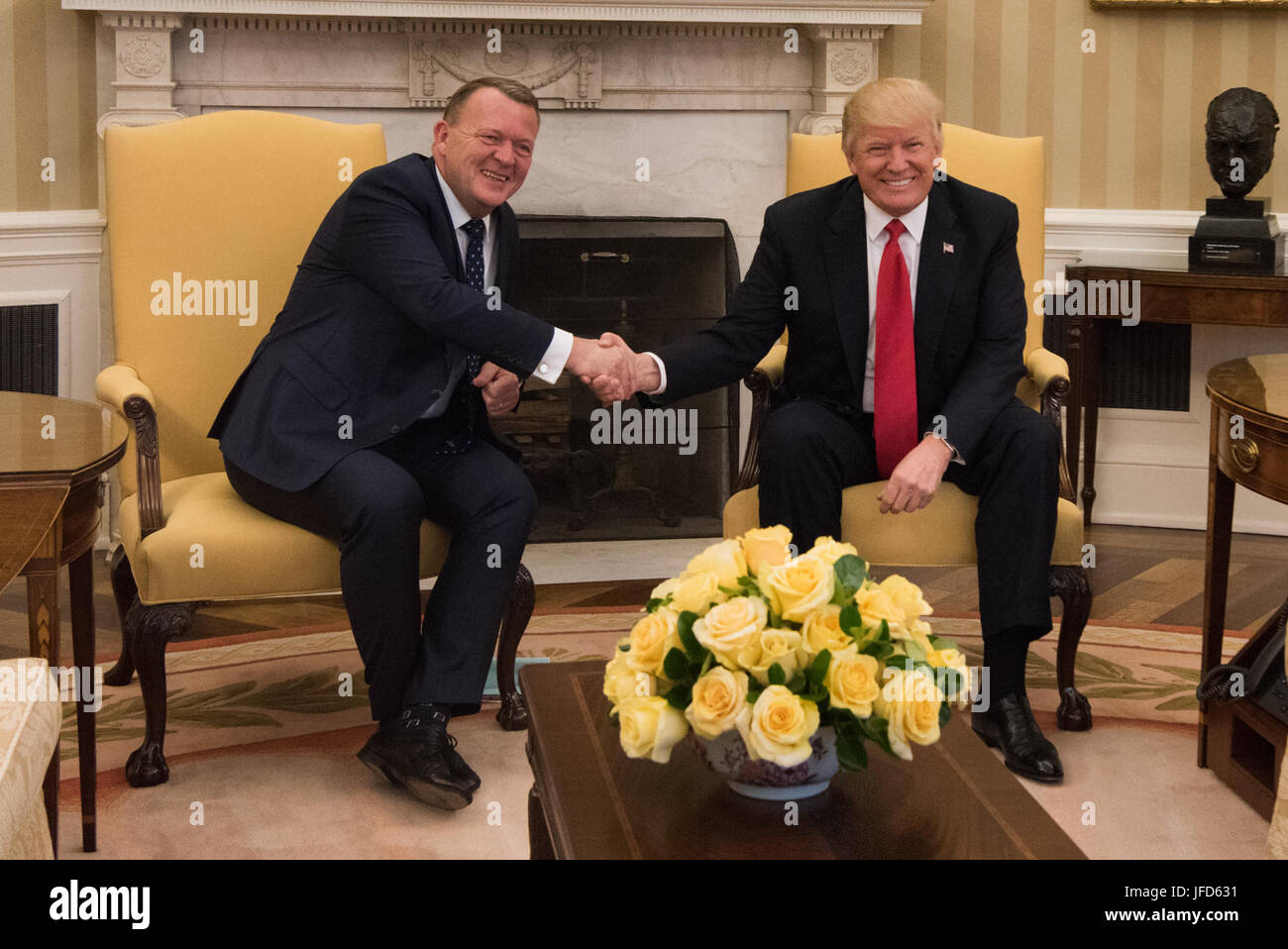 J trump and danish prime minister lars løkke rasmussen shake hands on thursday march 30 2017 during a meeting in the oval office of the white house
