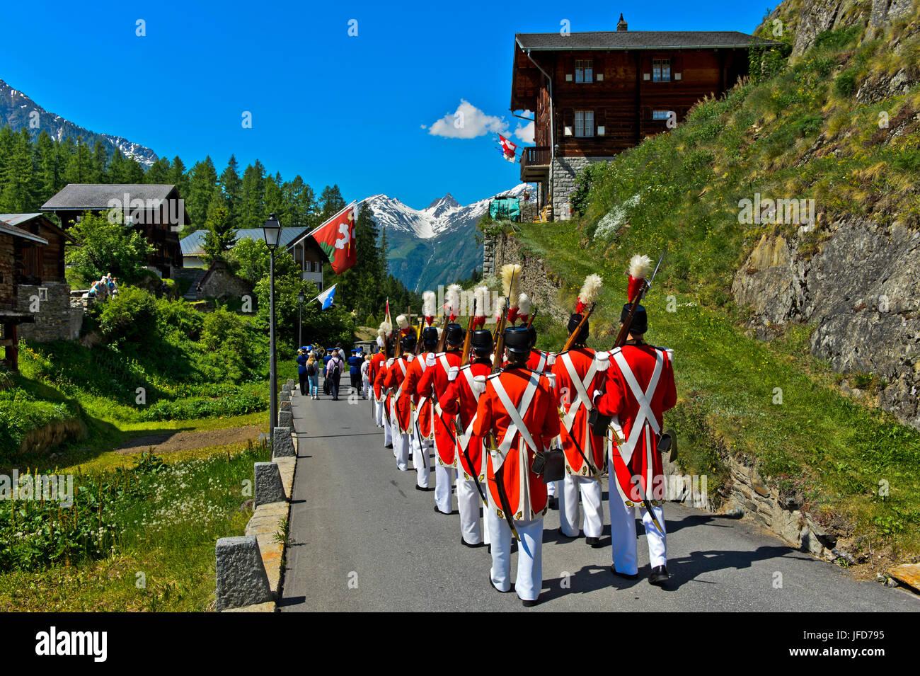 Herrgottsgrenadiere at the Corpus Christi procession, Blatten, Lötschental, Valais, Switzerland - Stock Image