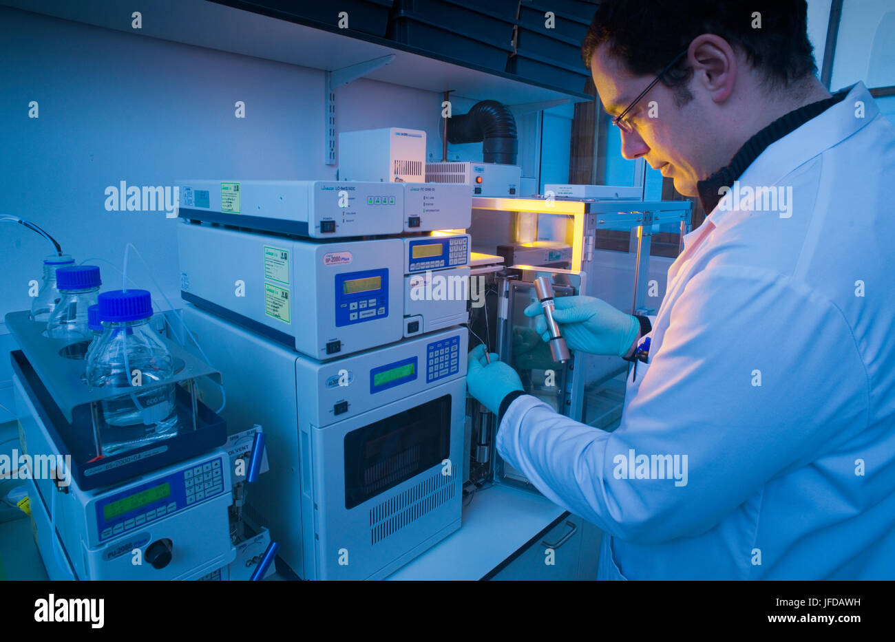 Loading a sample for purification using supercritical carbon dioxide as an extraction agent or solvent to remove - Stock Image