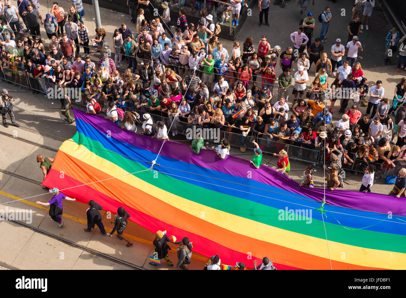 Toronto, Canada - 25 June 2017: Giant gay rainbow flag as seen from above during Toronto Pride Parade (Yonge-Dundas - Stock Image