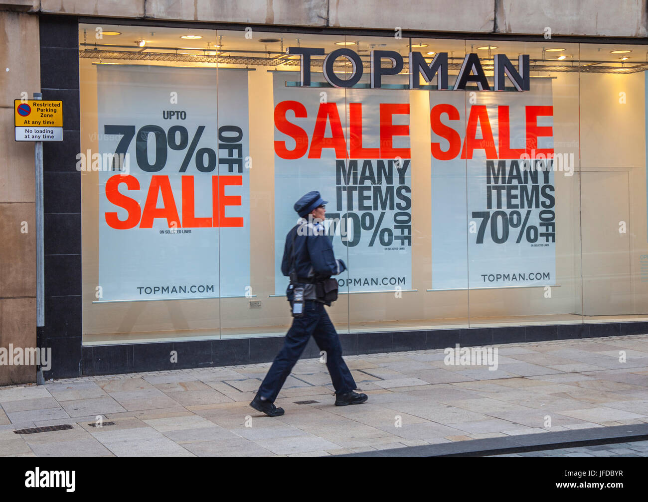 Shop front  Summer Sales Posters, in Fishergate, Preston, UK - Stock Image
