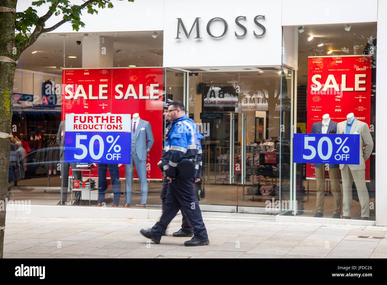 Moss Bros. Designer menswear Shop front  Summer Sales Posters, in Fishergatem Preston, UK - Stock Image