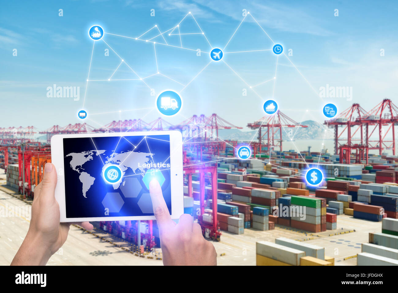 Hand holding tablet is pressing button Logistics connection technology interface global partner connection for logistic - Stock Image