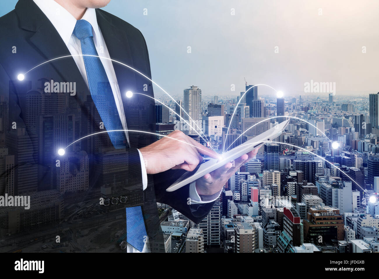 Double exposure of businessman using digital tablet pc with network connection of Osaka city. Network connection - Stock Image