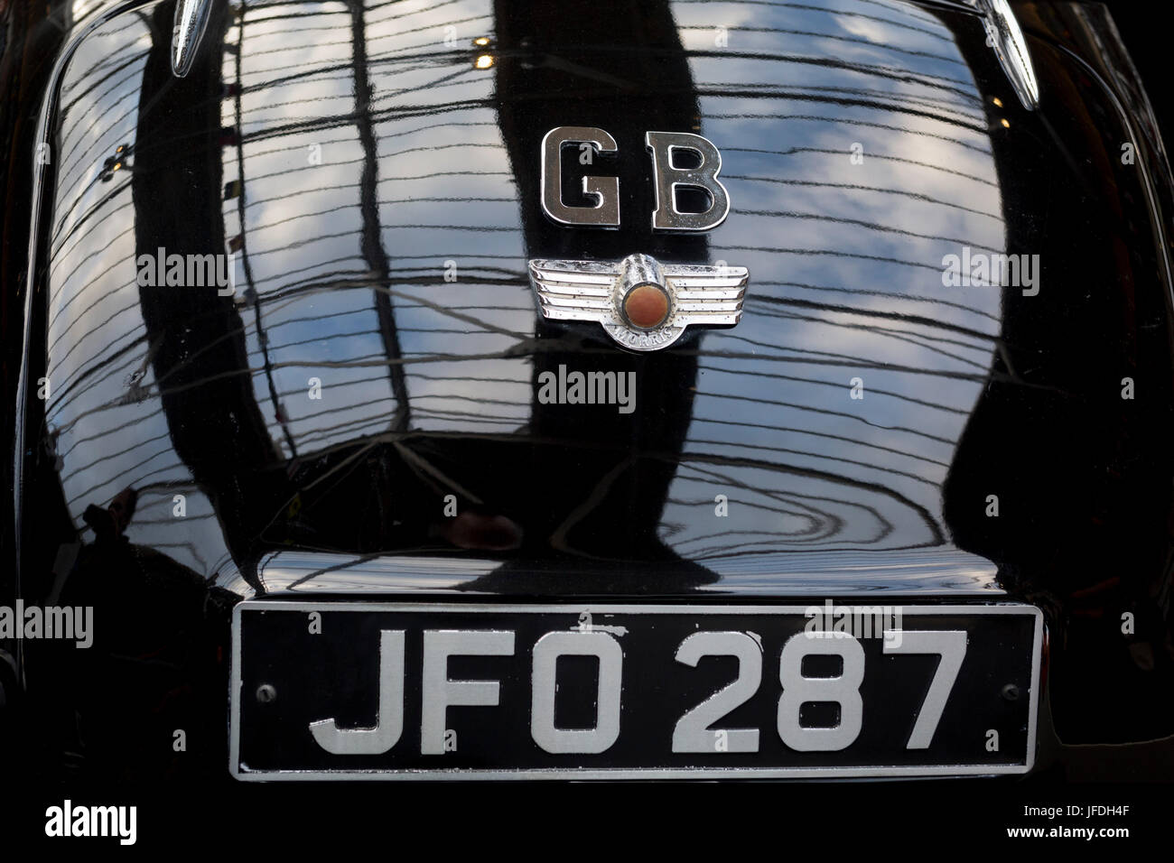 Detail of a GB car badge on the back of a British Morris Minor vintage car, on 29th June 2017, in Greenwich, London, - Stock Image