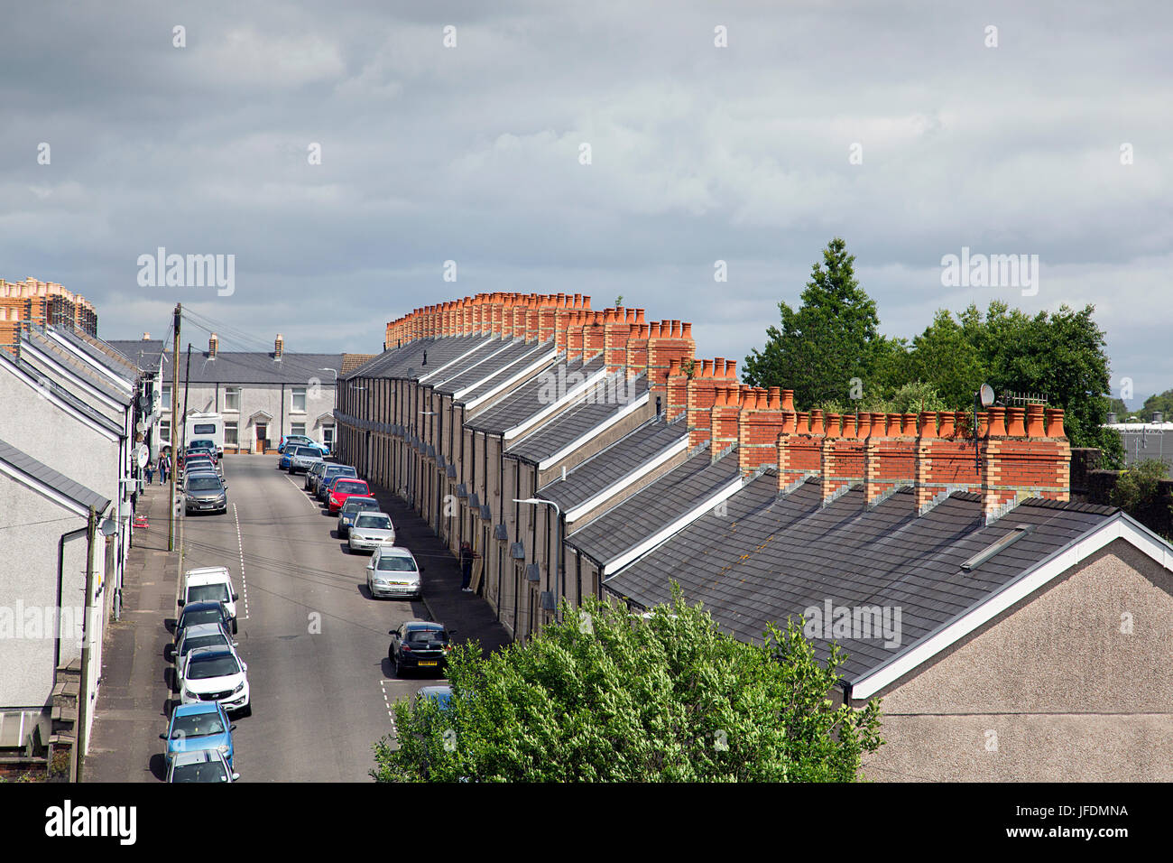 Rooftops and chimneys on a row of terraced houses in Wales - Stock Image