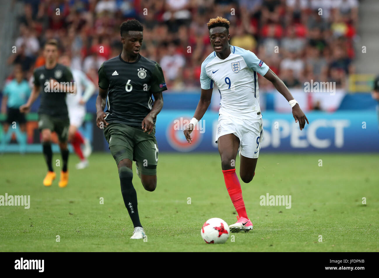 England's Tammy Abraham (right) and Germany's Gideon Jung battle for the ball - Stock Image