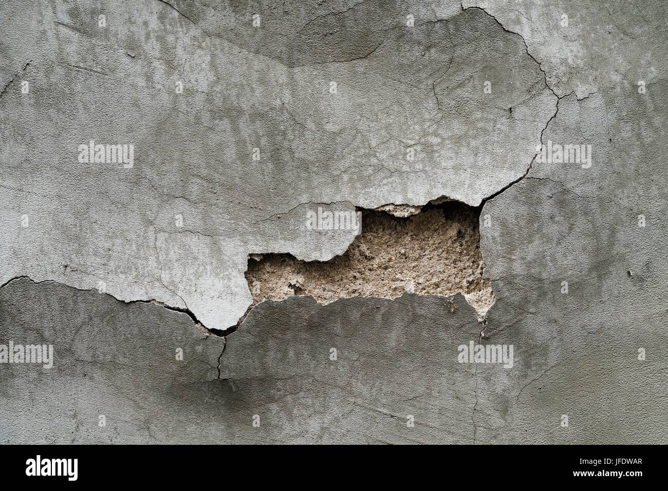 House wall with plaster damage - Stock Image