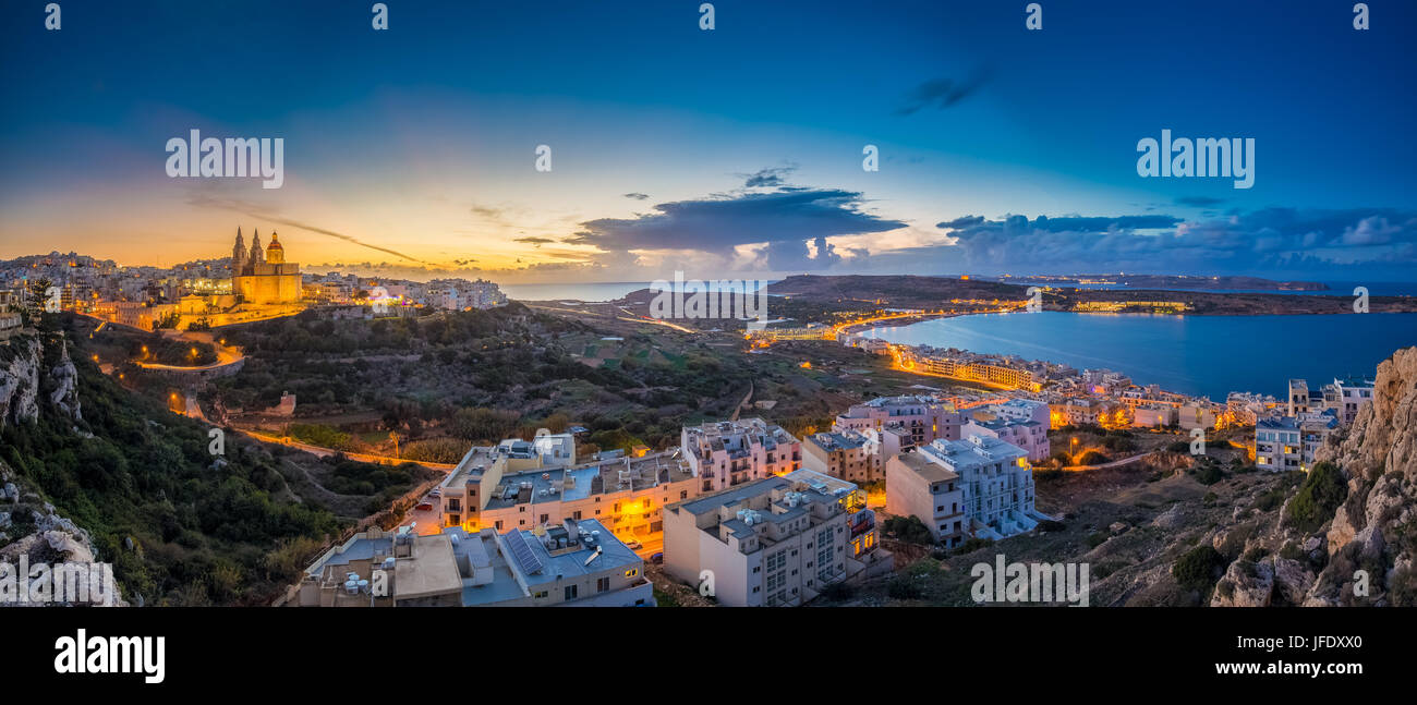 Il-Mellieha, Malta - Beautiful panoramic skyline view of Mellieha town at blue hour with Paris Church and Mellieha - Stock Image