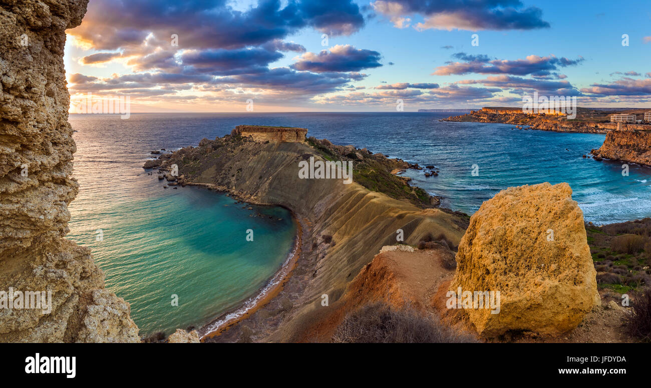 Mgarr, Malta - Panorama of Gnejna and Ghajn Tuffieha bay, the two most beautiful beach in Malta at sunset with beautiful - Stock Image