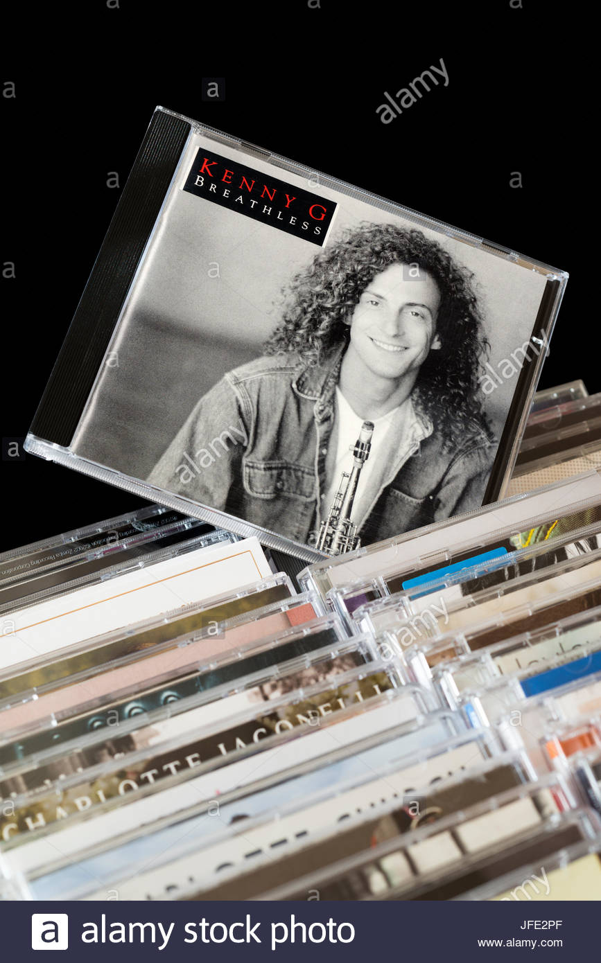 Breathless, Kenny G CD pulled out from among rows of other CD's, Dorset, England - Stock Image