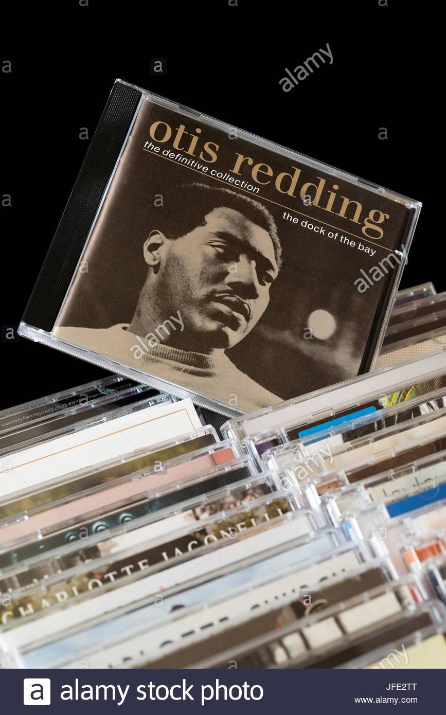The Dock Of The Bay, Otis Redding Greatest Hits CD pulled out from among rows of other CD's, Dorset, England - Stock Image