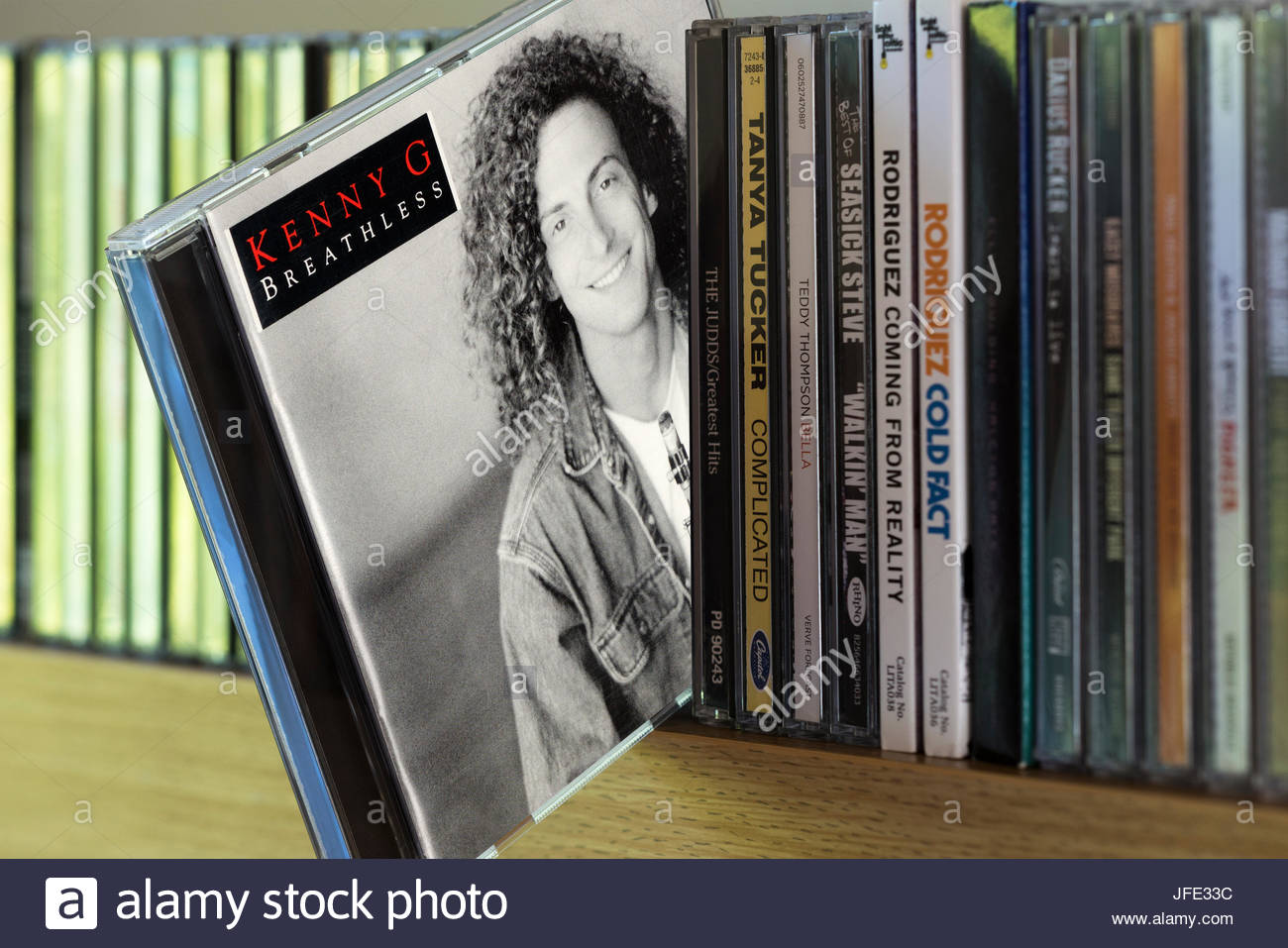 Breathless, Kenny G CD pulled out from among other CD's on a shelf, Dorset, England - Stock Image