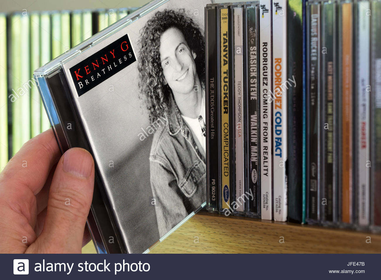 Breathless, Kenny G CD being chosen from a shelf of other CD's, Dorset, England - Stock Image