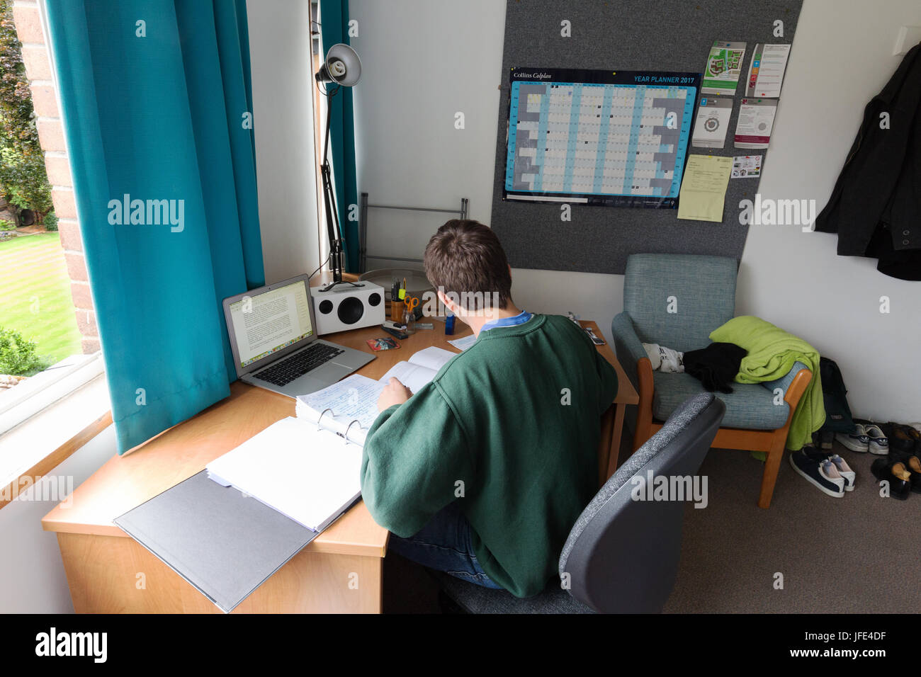 University student studying for exams in his room, Queens College, Cambridge University, Cambridge England UK - Stock Image