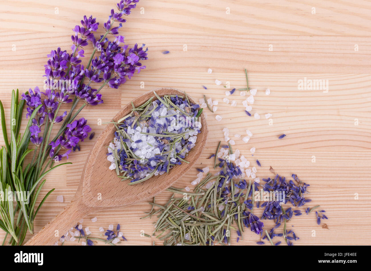 spoon with Herb salt of rosemary and lavender blossoms - Stock Image