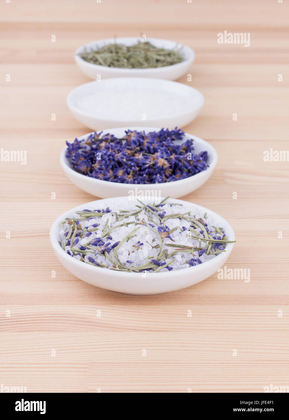 Herb salt with rosemary and lavender blossoms - Stock Image