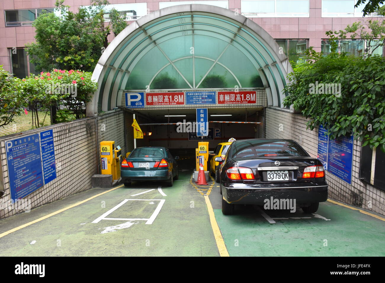 This is underground paid parking at Mackay Hospital in Taipei, Taiwan. Parking is scares and expensive. - Stock Image