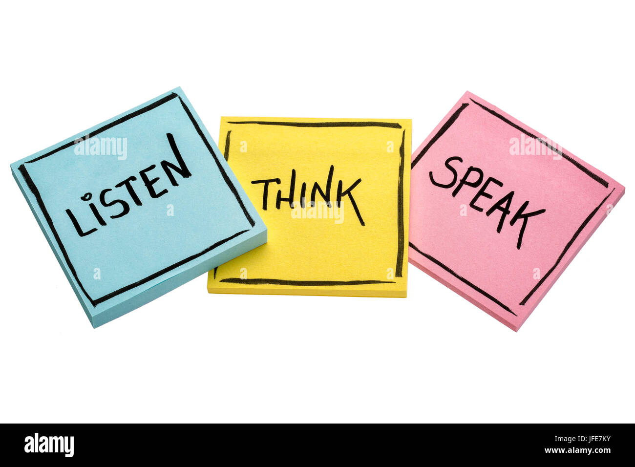 listen, think, speak - communication concept - handwriting in black ink on isolated sticky notes - Stock Image