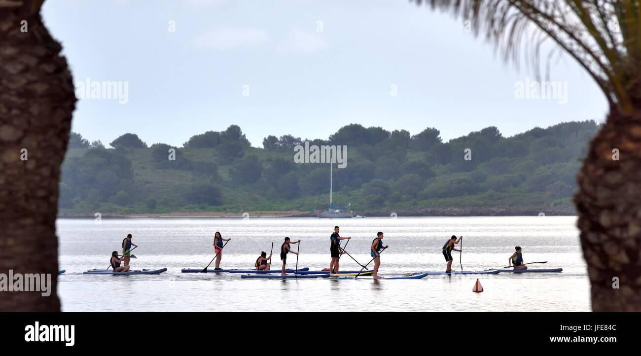 Schoolchildren Paddle boarding - Stock Image