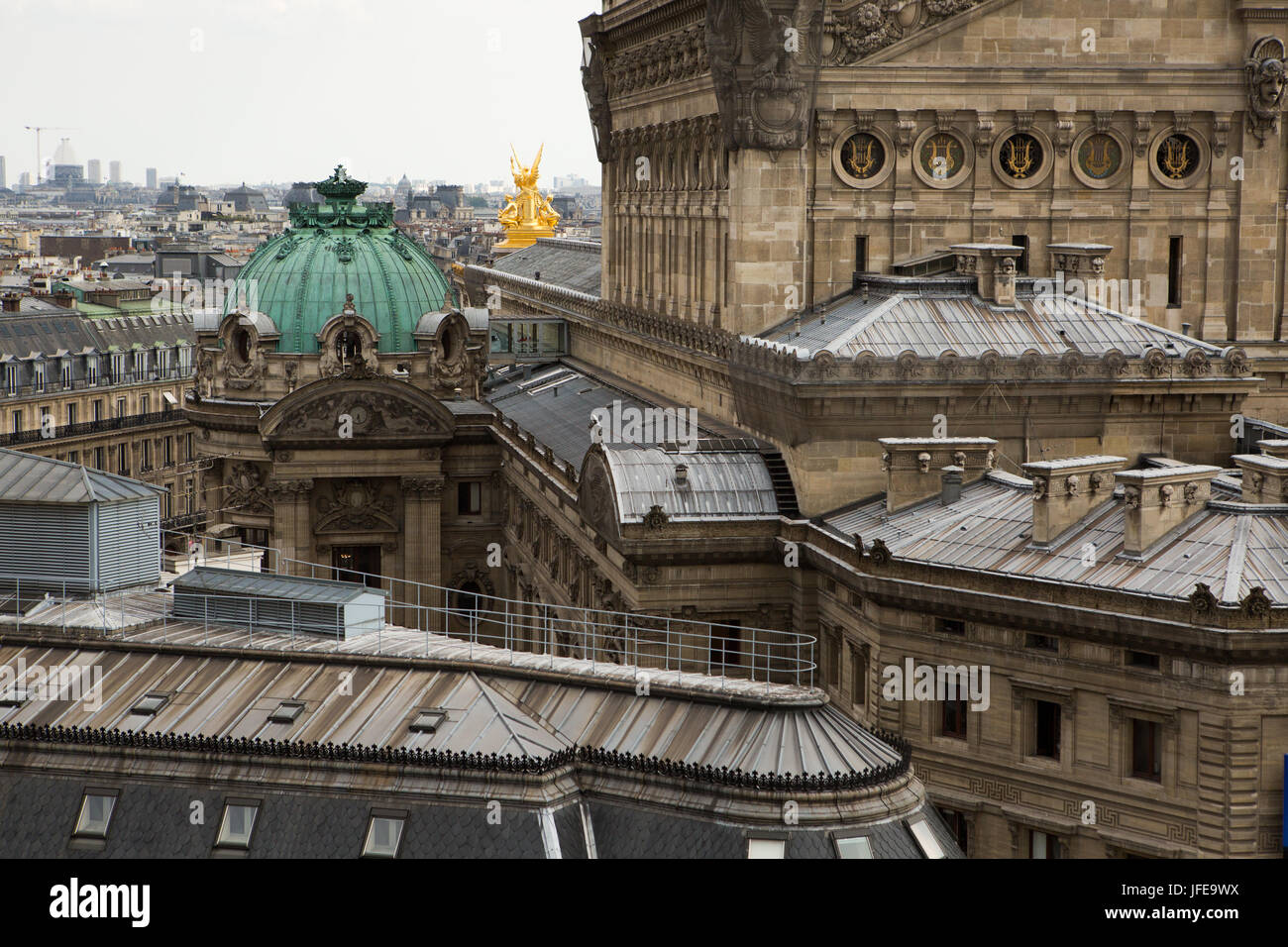 The architecture of the Paris Opera House, Garnier Palace, against the city backdrop. - Stock Image