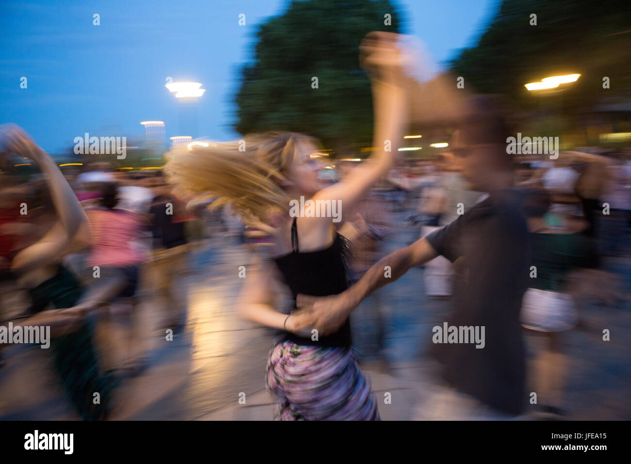 On summer nights Parisians learn and dance the tango. - Stock Image