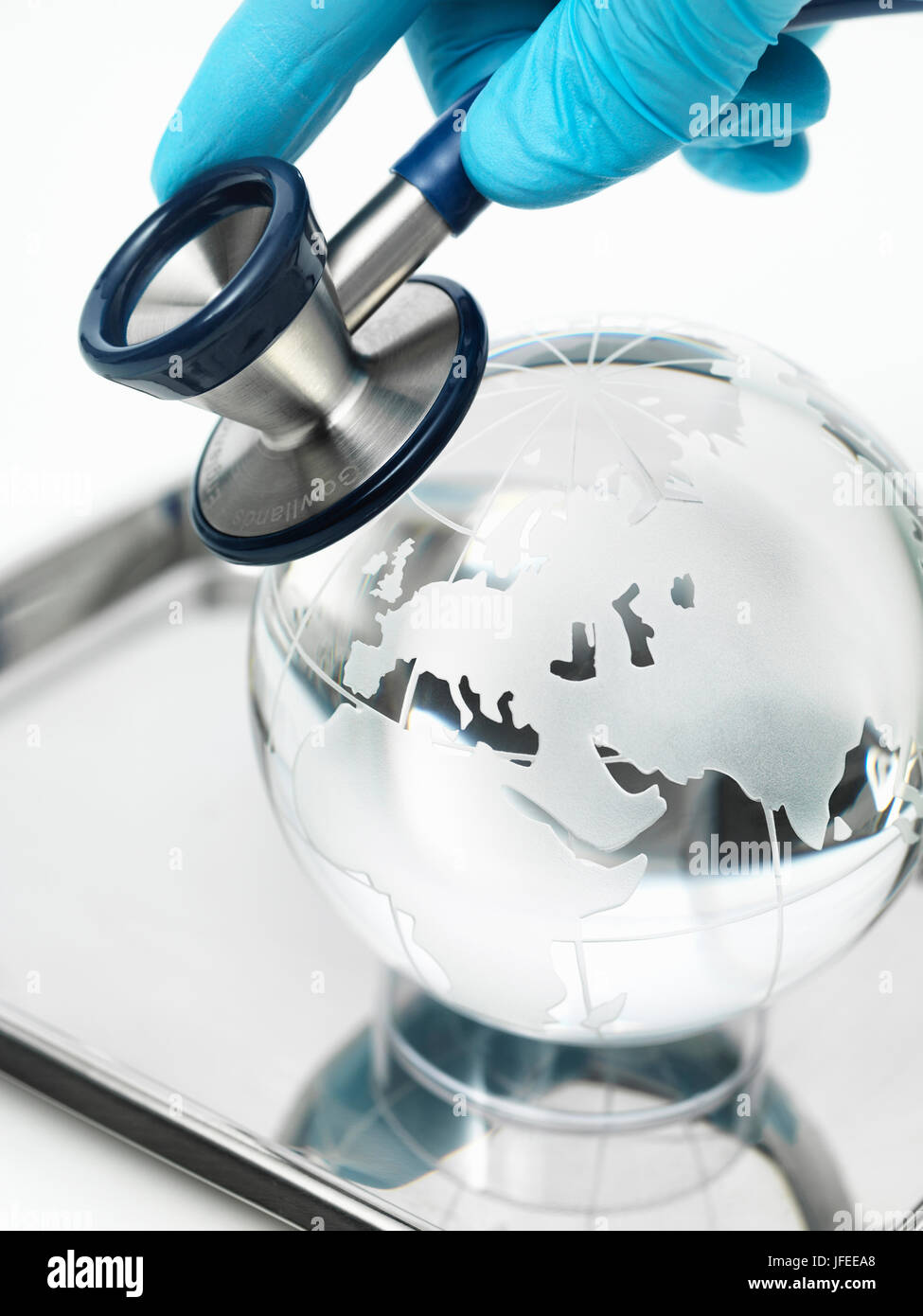 Global healthcare, conceptual image. Globe and stethoscope. - Stock Image