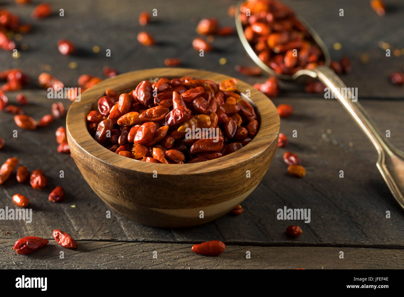Organic Dry Small Pequin Chili Peppers in a Bowl - Stock Image