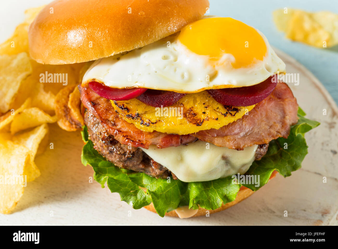 Homemade Aussie Pineapple and Beet Cheeseburger with Egg and Bacon - Stock Image