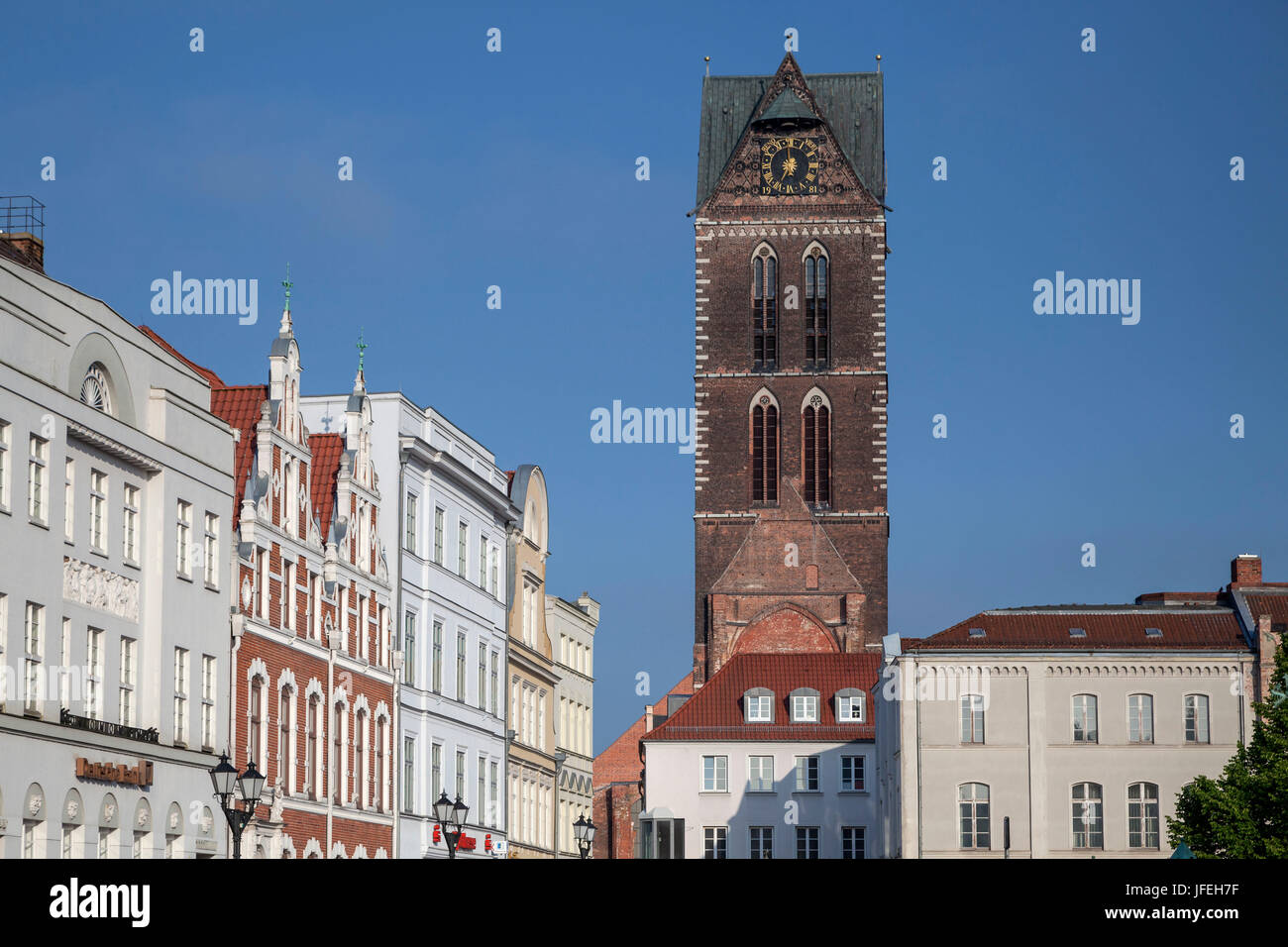 Marien's steeple behind houses on the marketplace, Hanseatic town Wismar, Mecklenburg, Mecklenburg-West Pomerania, - Stock Image
