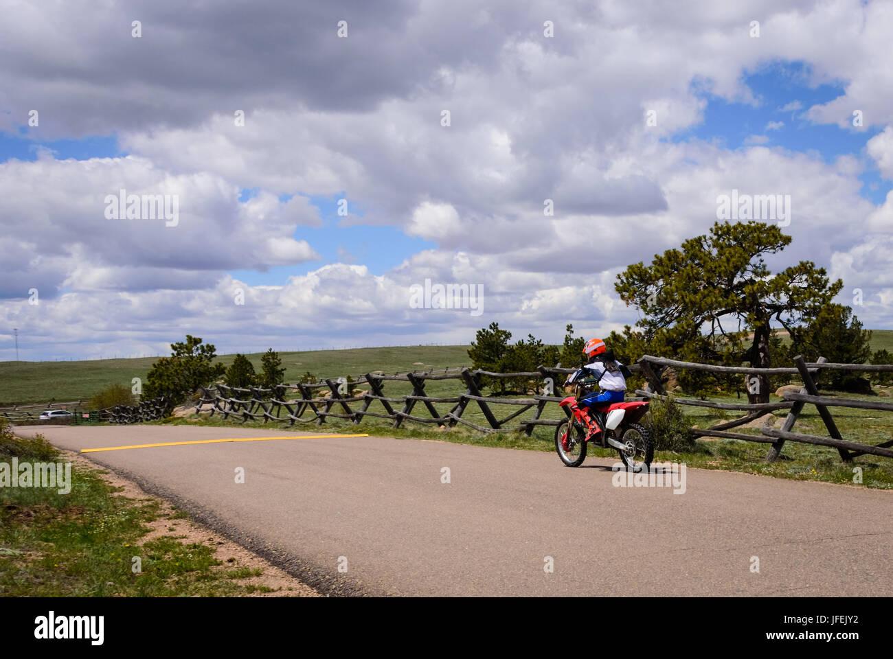 A kid, boy on a dirt bike. Motocross race, racing, USA - Stock Image