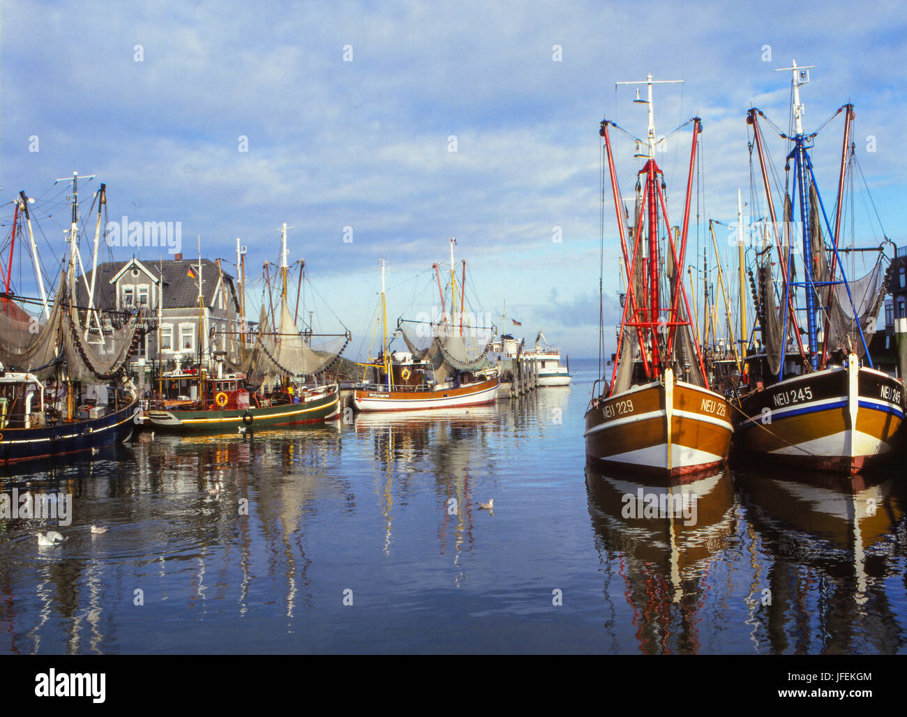 Crab cutters in the harbour of Neuharlingersiel, East Friesland, North Germany, Germany - Stock Image