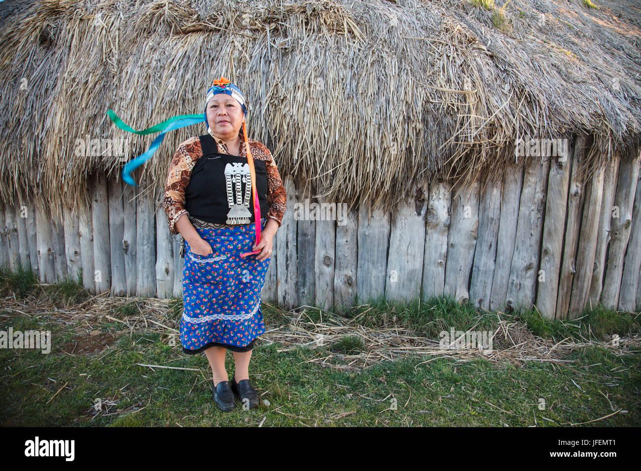 Chile, Araucania, Llaguepulli, Mapuche, Ruka, round house, woman, traditional costume, - Stock Image