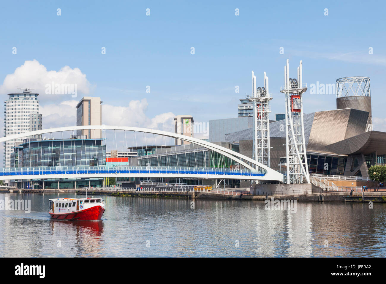 England, Manchester, Salford, The Quays, The Lowry and Millenium Lift Bridge - Stock Image