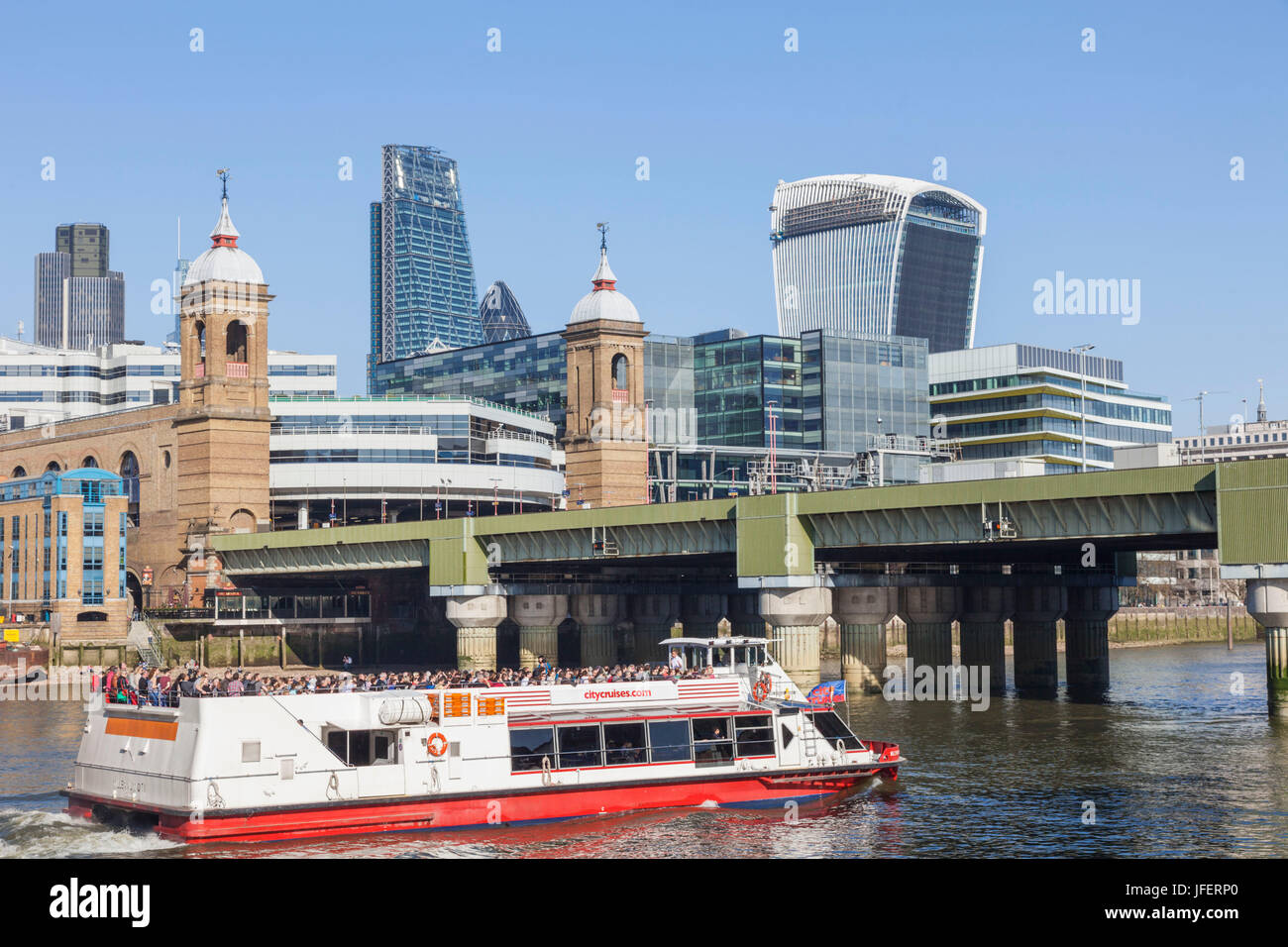 England, London, The City, Tour Boat Passing City Skyline and Cannon Street Station - Stock Image