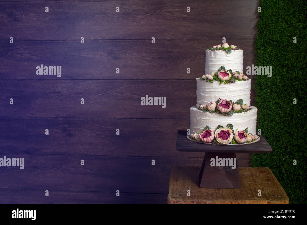 Pleasing Beautiful Tiered Birthday Cake On A Dark Wooden Background Stock Funny Birthday Cards Online Inifofree Goldxyz