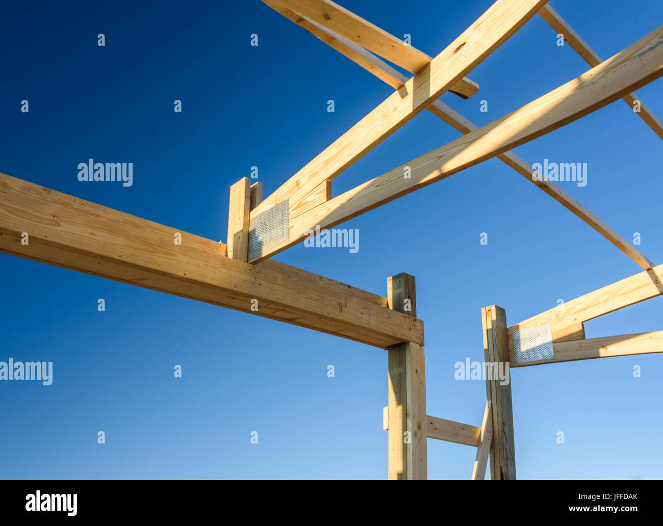 Garage truss pole building. Timber, wooden truss attachment. Construction site framing - Stock Image