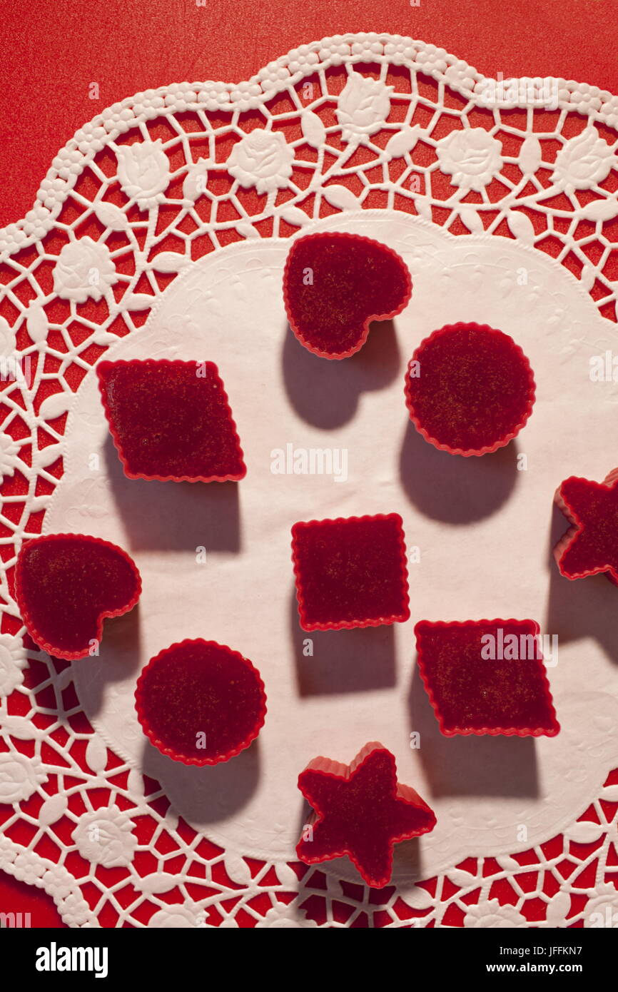 Red marmalade in molds on white napkin - Stock Image