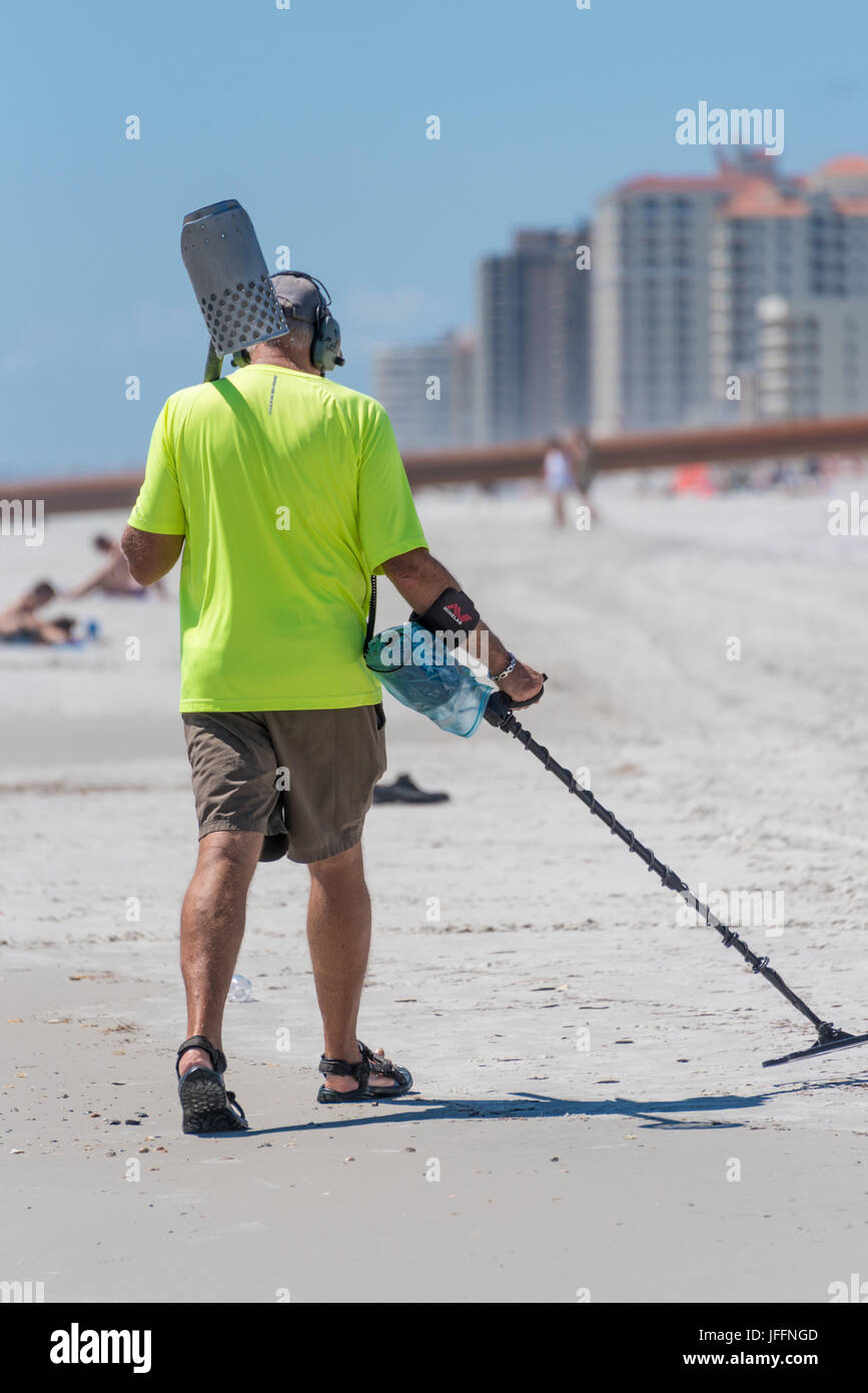 Beachcomber with metal detector scanning the shoreline at Jacksonville Beach, Florida. (USA) Stock Photo