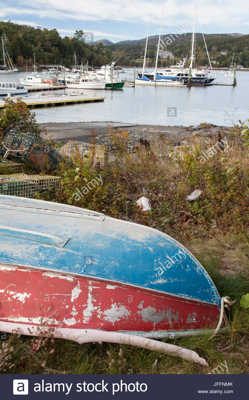 An old boat overturned on the shore of Northeast Harbor. - Stock Image