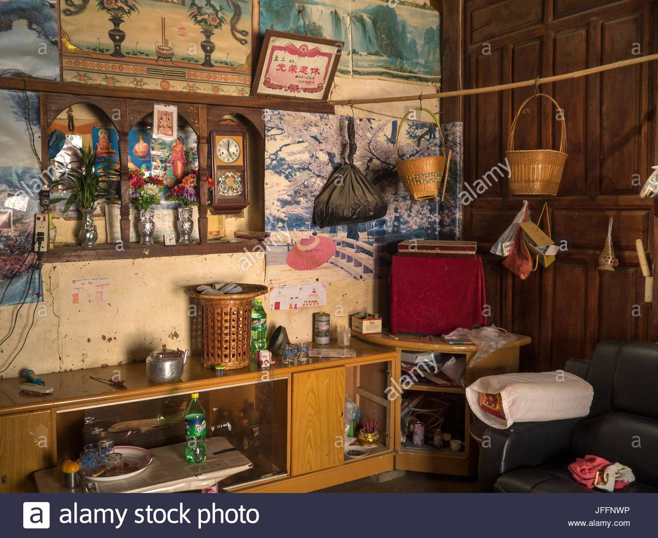 The interior of a Deang minority home in Yunnan Province. - Stock Image
