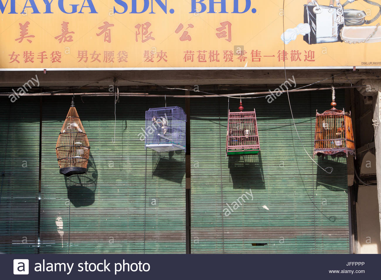Wild bird species are caged and sold as songbirds in markets throughout Kuala Lumpur. - Stock Image