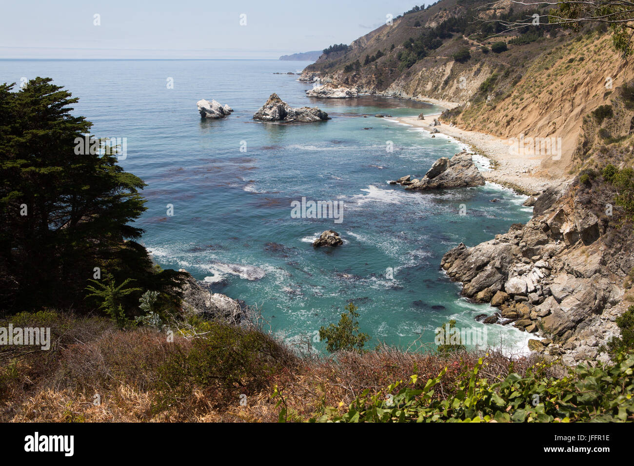 A view of the Pacific Ocean and beaches from the rocky Big Sur coast. Stock Photo