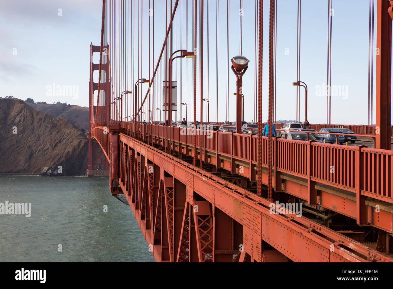 Bicyclists and cars crossing the Golden Gate Bridge. - Stock Image