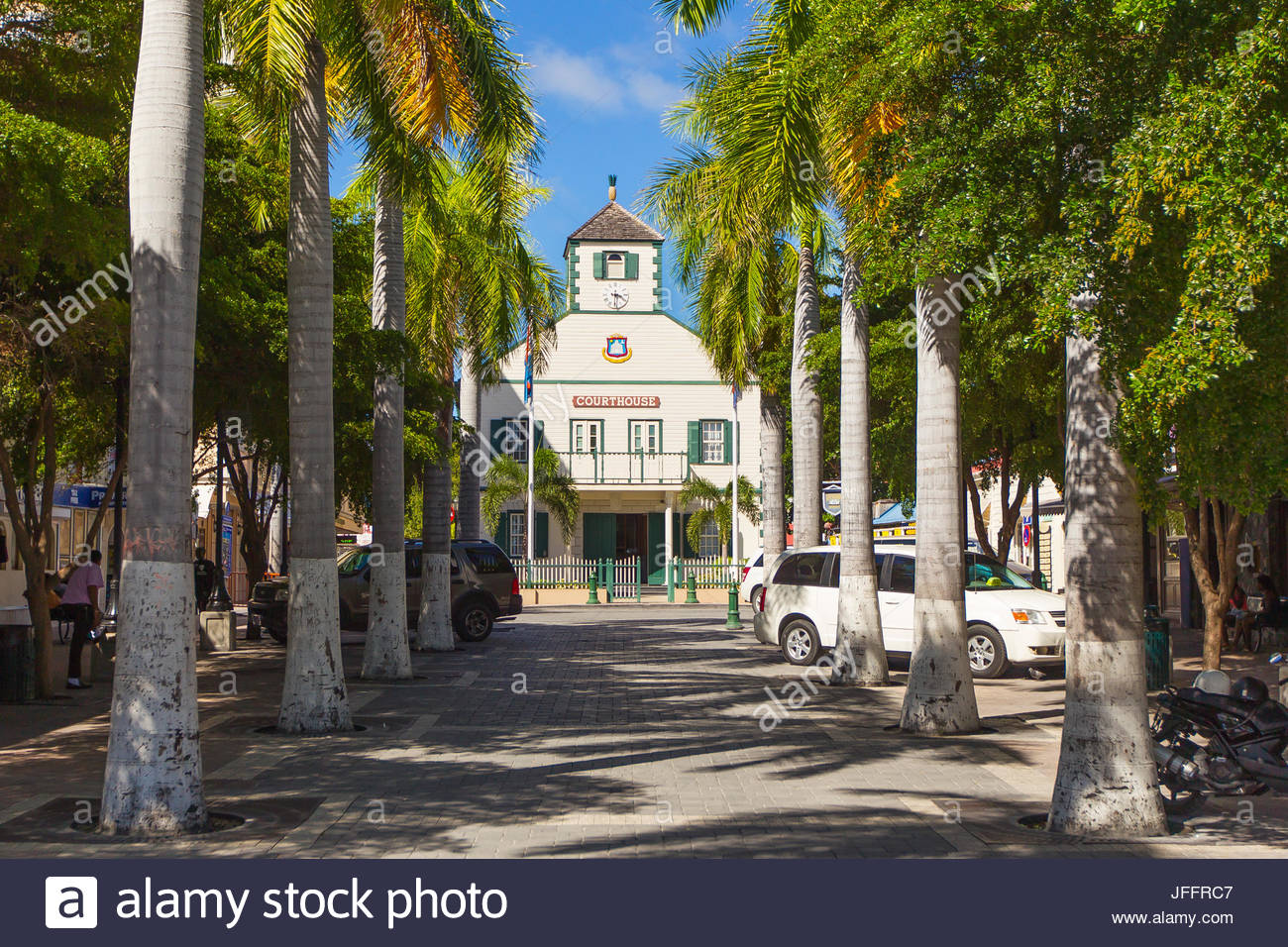 The Courthouse in downtown Philipsburg, at the end of a row of palm tree-lined parking spaces. - Stock Image