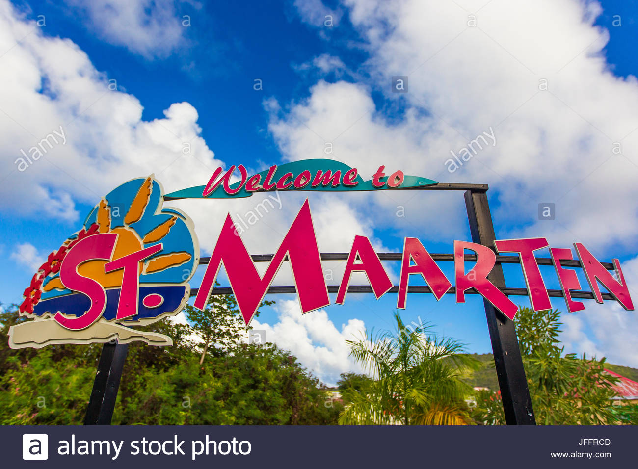 A colorful sign welcoming visitors to tropical Saint Martin Island. - Stock Image
