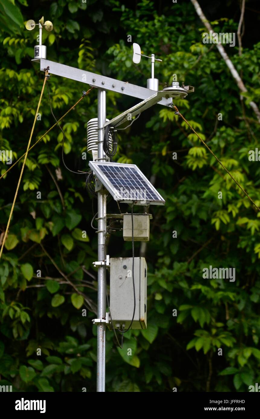 A solar panel at a weather station on Barro Colorado Island. - Stock Image