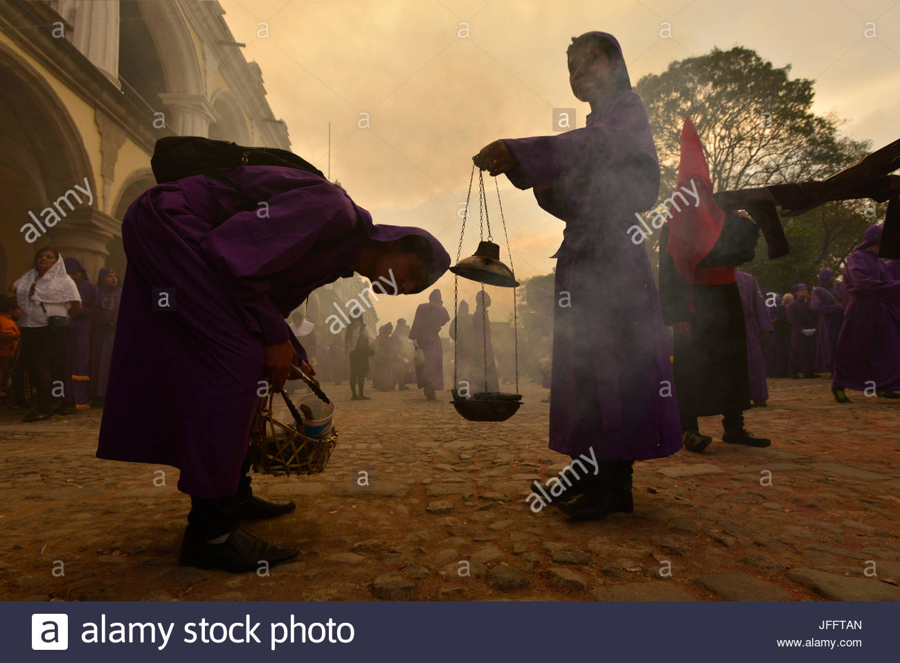 A member of the San Francisco Brotherhood bows before a censer during Holy Week celebrations in Antigua. - Stock Image