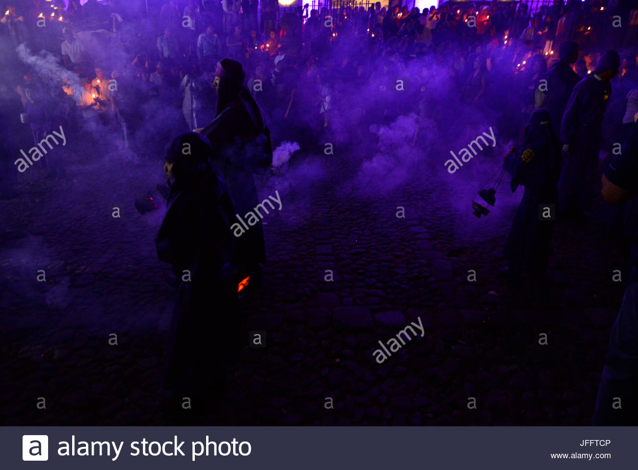 Penitents during a Holy Week Procession in Antigua. - Stock Image